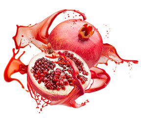 pomegranates in red juice splash isolated on a white background