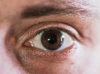 Eye close up of 30's white man