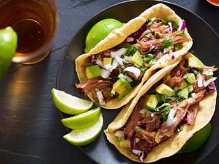 Wall Mural - tasty pork street tacos with onion, cilantro, avocado, and red cabbage