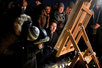 Canada's Prime Minister Justin Trudeau attends a candle light vigil for the victims of Ukraine International Airlines flight PS-752 on Parliament Hill in Ottawa