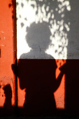 Girl's shadow in the wall