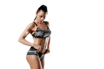 Sporty woman workout and posing. Fitness girl with perfect slim and fit body with dumbbells isolated
