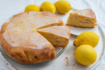 Lemon pound cake on rustic wooden background