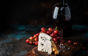 Port wine and blue cheese, still life in rustic style, vintage wooden table background, selective...