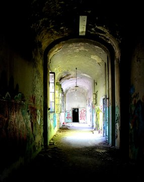 2019.06.16 - Limbiate, Milan, Italy, photographic reportage madhouse in Mombello, abandoned psychiatric hospital long macabre corridor with spray paint on the walls
