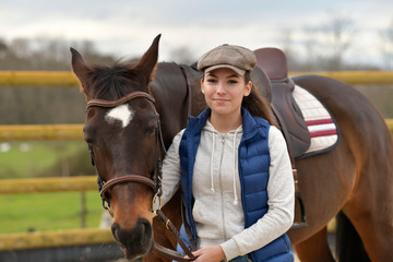 Portrait of horsewoman and horse