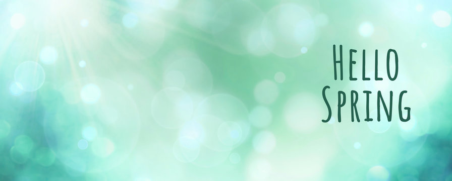 Abstract green spring background banner - hello spring text - greeting card with beautiful bokeh lights
