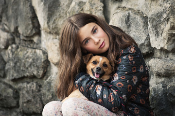 beautiful teen girl hugging her new pet friend dog from rescue shelter