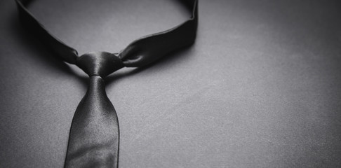Black tie on the black background.
