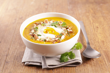 Fotobehang - bowl of pumpkin soup with cream