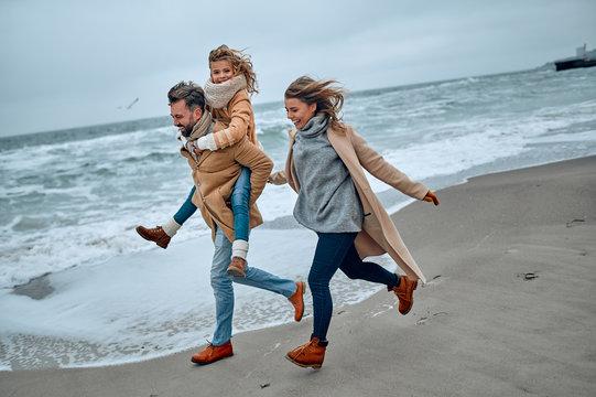 Family on the beach near the sea