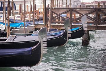 Foto op Canvas Gondolas Venice, Italy - March 1, 2019: Gondolas docked at the pier of San Marco square.