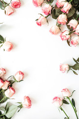 Wall Murals Floral Round frame border of pink rose flowers on white background. Mockup blank copy space. Flat lay, top view floral composition.