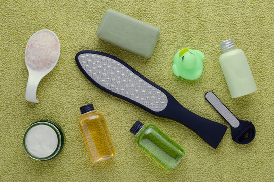 feet care products, laser grater, cream, lotion and soap with pink salt