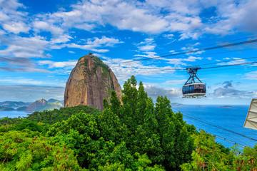 Fototapete - The cable car to Sugarloaf in Rio de Janeiro, Brazil. Skyline of Rio de Janeiro.