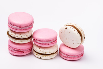 Aluminium Prints Macarons French Colorful Strawberry and Caramel and Salt Macarons Colorful Pastel Macarons on White Background White and Pink Macarons Horizontal