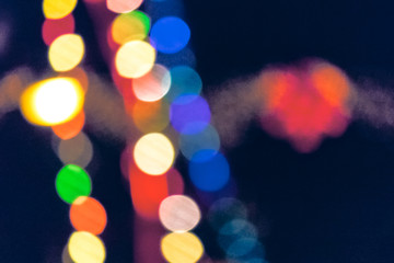 christmas lights on the streets at night. abstract blurred background toned in blue