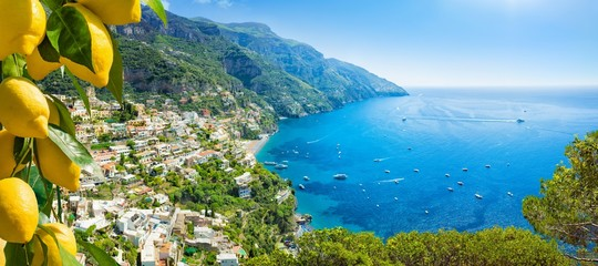 Poster Blue sky Beautiful Positano and clear blue sea on Amalfi Coast in Campania, Italy. Amalfi coast is popular travel and holyday destination in Europe.