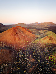 Volcanoes at sunset in Lanzarote, Canary Islands. Aerial view