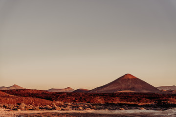 Volcanoes National Park, Lanzarote. Sunset view over a martian landscape