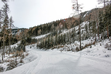 Landscape of mountains and winter road.Free space for your decoration.