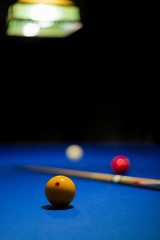 Three-cushion billiards Game consist in to carom the cue ball off both object balls and contact the rail cushions at least three times before the last object ball. Carom billiards concept