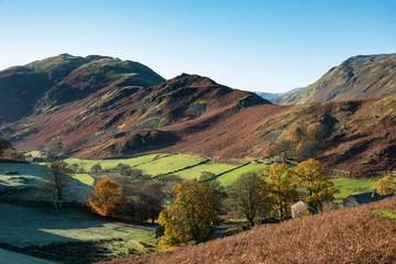 Photo sur Plexiglas Bleu vert Majestic Autumn Fall landscape image of Sleet Fell and Howstead Brow in Lake District with beautiful early morning light in valleys and on hills