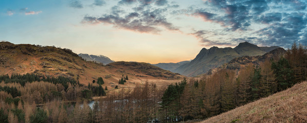 Photo Stands Deep brown Majestic drone landscape image of Blea Tarn in Lake District during Autumn Fall sunrise