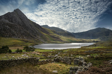 Aluminium Prints Dark grey Epic image of sky over landscape of Tryfan and Llyn Ogwen in Snowdonia Wales