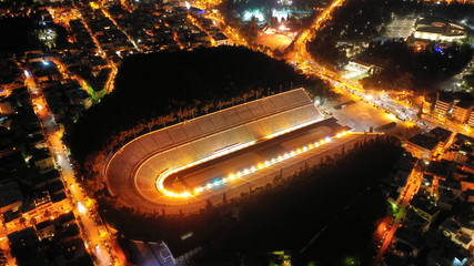 Aerial drone night shot of beautiful illuminated Panathenaic stadium in cityscape of Athens, Attica, Greece Wall mural