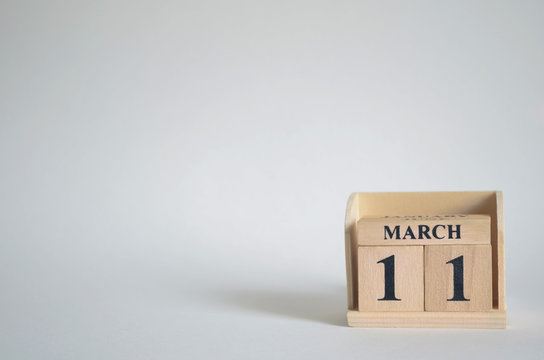 March 11, Empty white background with number cube on the table.
