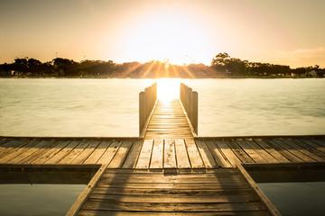 Boardwalk pier over the estuary at sunset