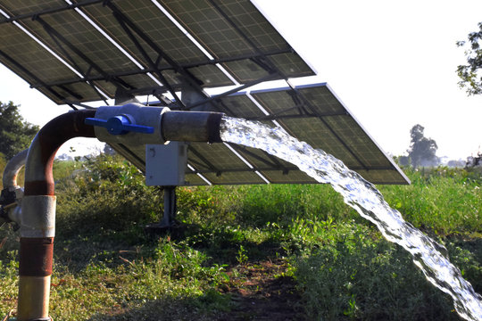 agricultural equipment for field irrigation, water jet, behind which is solar panel's,