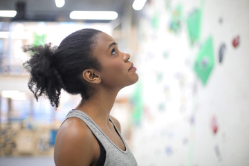 Girl training in a climbing centre