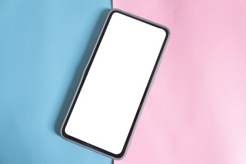 Smart phone with white blank screen on two tone (blue and pink) background