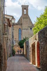 Street in the historic centre of San Gimignano town, Italy
