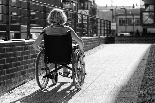 woman on wheelchair entering the platform