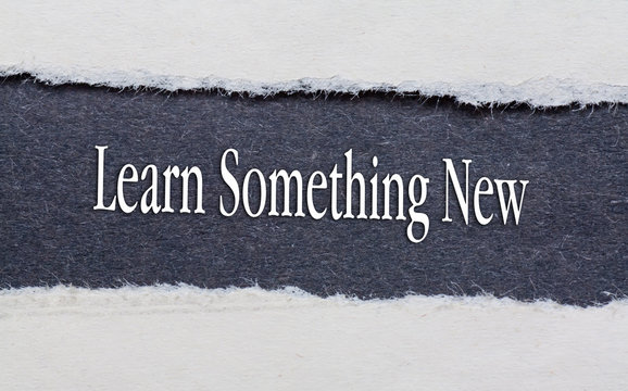 Rip Blue Paper and white background with learn something new written on