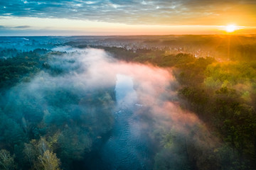 Wall Murals Forest river Mist over river at sunrise, view from above