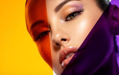 Obraz Beautiful white girl with bright eye-makeup. Beautiful fashion woman with  a colored  items.   Glamour fashion model with bright gloss make-up posing at studio. Stylish fashionable concept. Art. - fototapety do salonu