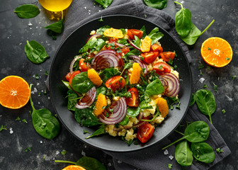 Vegetable Millet salad with red onion, cherry tomatoes, spinach, tangerine and clementine dressing....