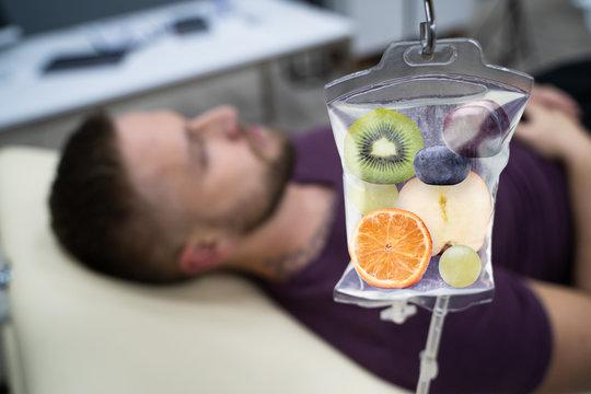 Fruit Slices Inside Saline Bag Hanging In Hospital