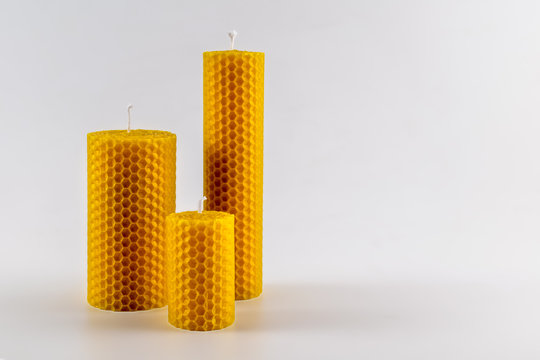 Beeswax candles isolated. Copy space for text. Natural aromatic, decorative beeswax candles.