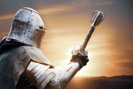 Medieval knight posing with sword.