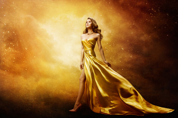 Woman in Gold Dress Looking to Space Stars, Beautiful Fashion Model on Golden Night Sky Wall mural