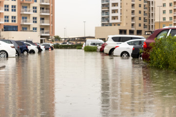 Cars stuck in water in a flooded parking lot after heavy in rain in Dubai