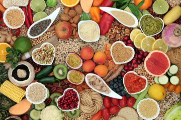 Healthy vegan super food diet with fruit, vegetables, nuts, spice, pasta, dips, spice & grains. High in protein, vitamins, minerals, antioxidants, dietary fibre & smart carbs. Ethical eating concept.