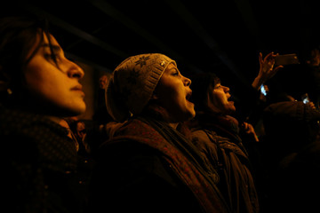 A woman shouts slogans as she gathers with people to show their sympathy to the victims of the crash of the Boeing 737-800 plane, flight PS 752, in Tehran
