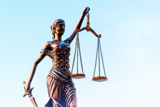Law and Order, legal symbol the Scales of Justice set against blue sky.