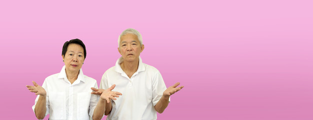 Asian elder old couple unhappy angry with situation copy space
